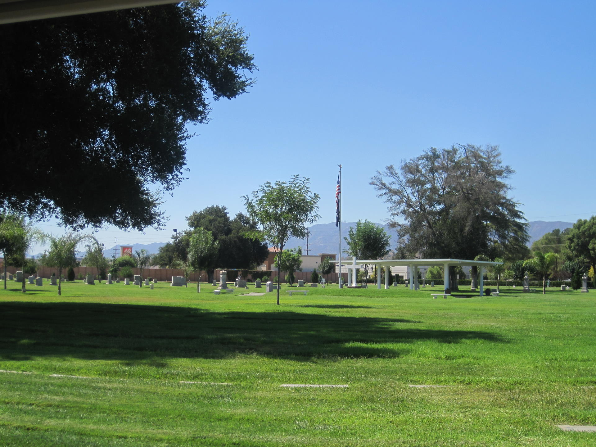 wide view of cemetery grounds with flat grave markers