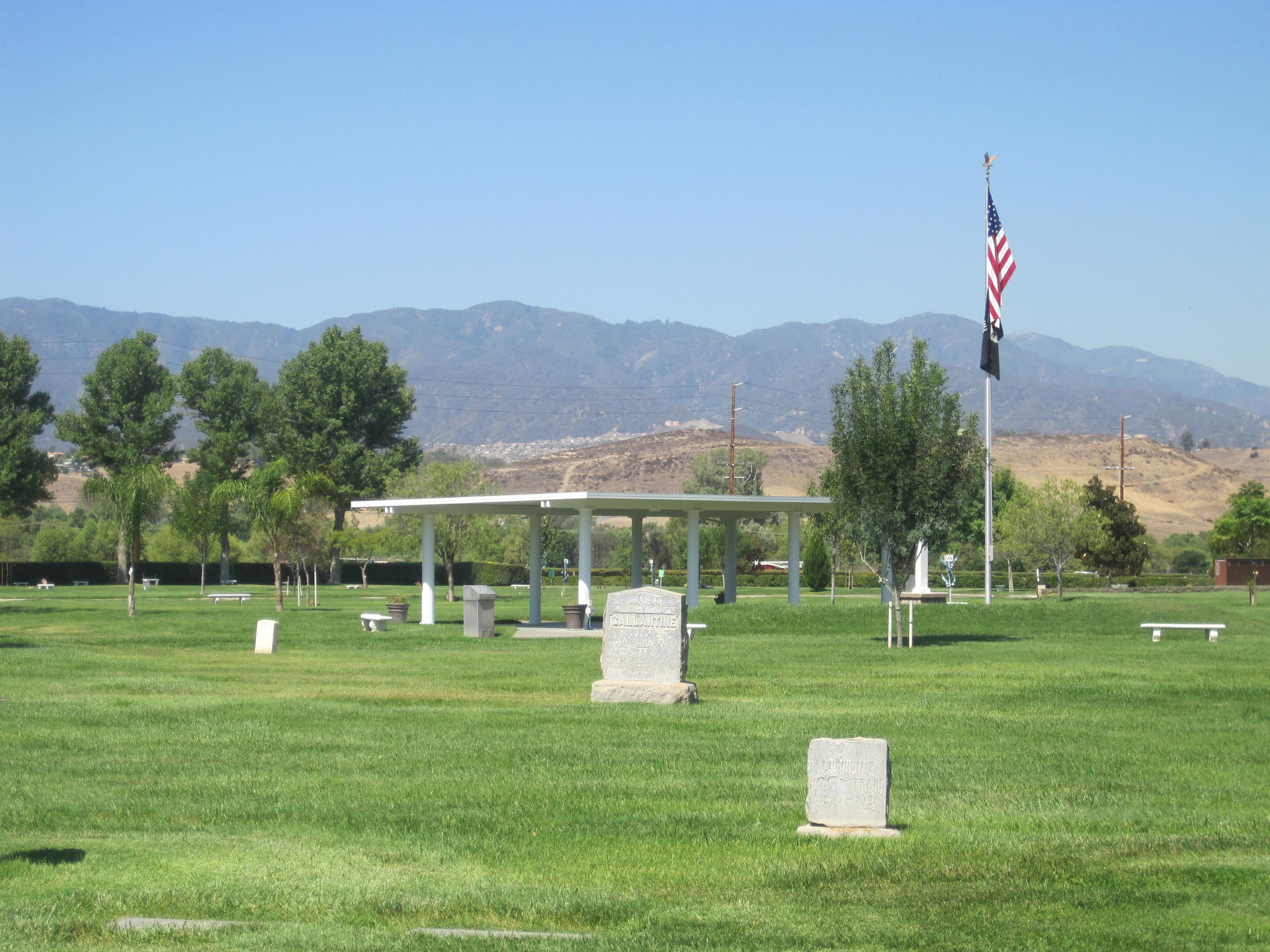 view of cemetery pavilion next to a flag pole