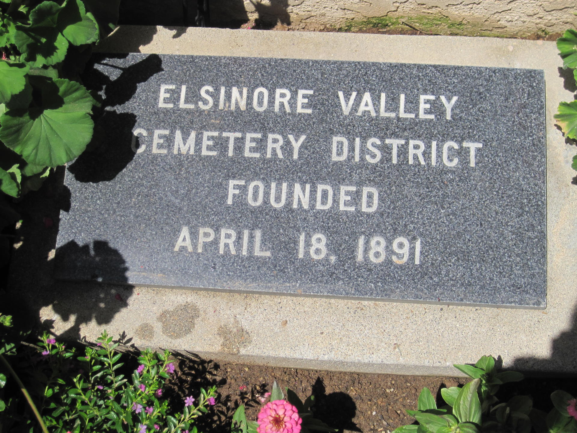 flat stone marker that says Elsinore Valley Cemetery District Founded April 18, 1891