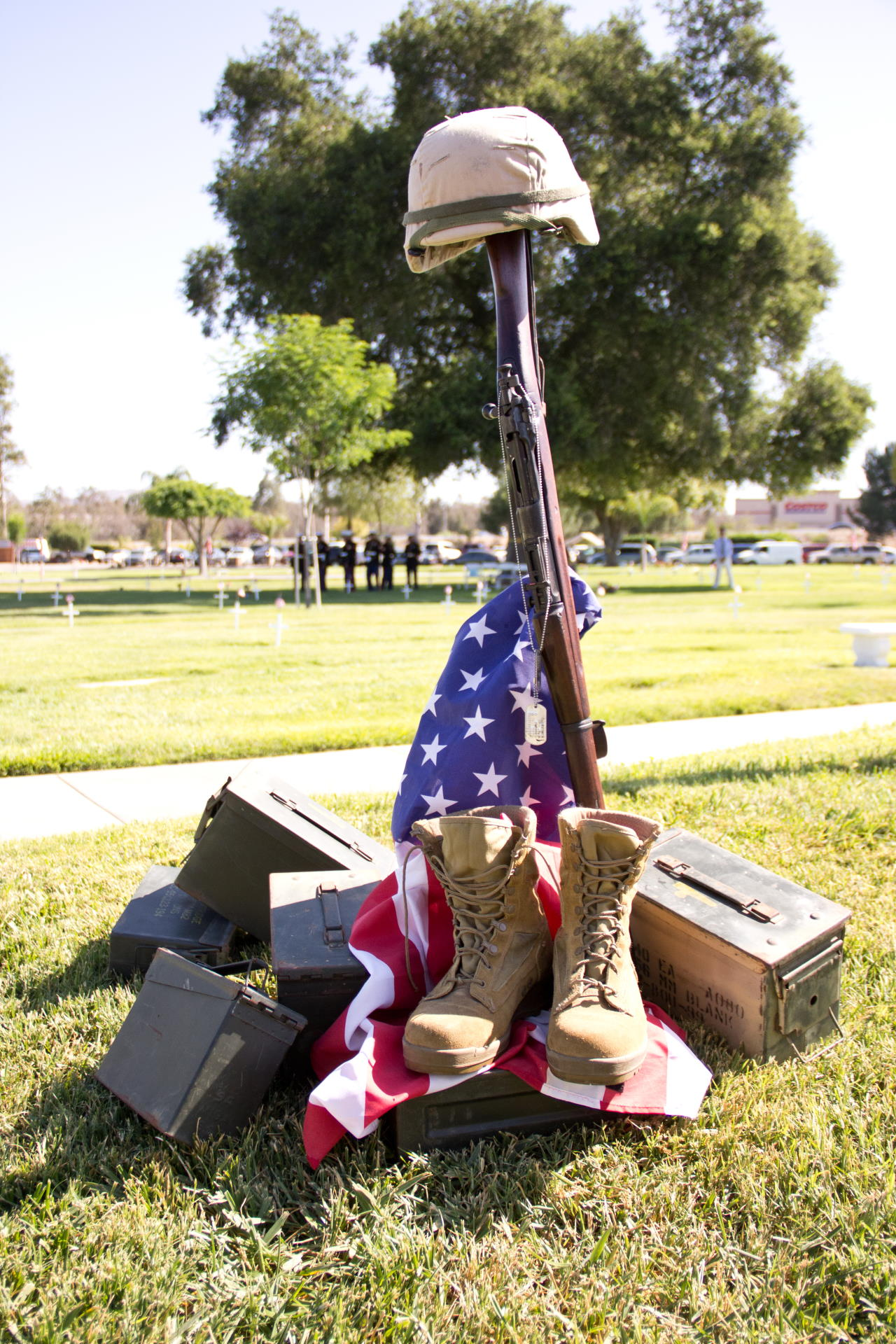 assortment of military items, including boots, a flag and a helmet