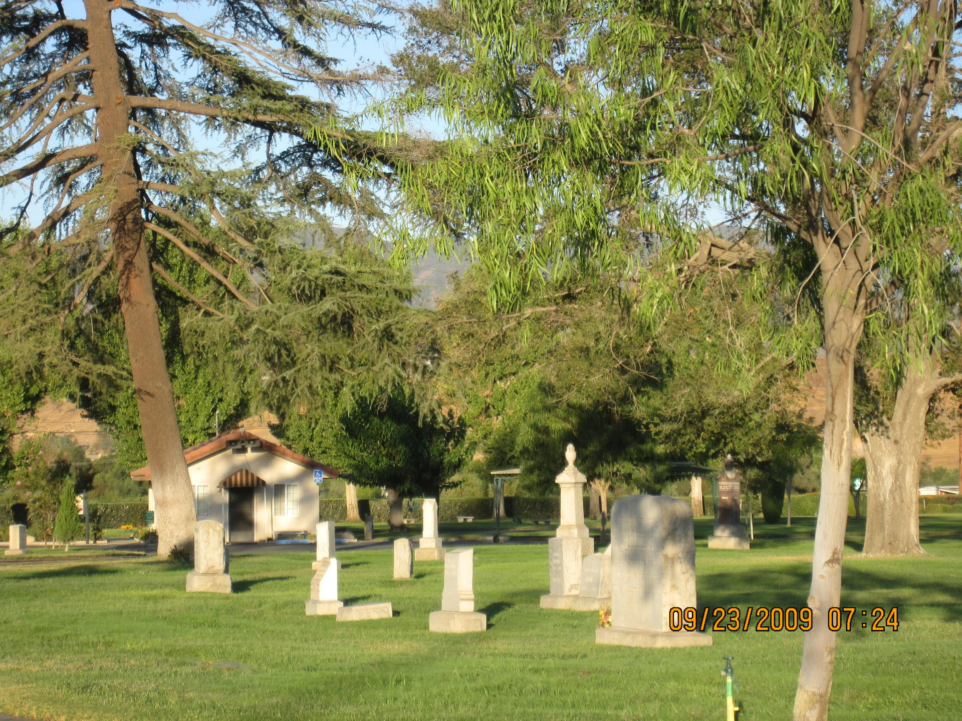 view of burial grounds with tall headstones