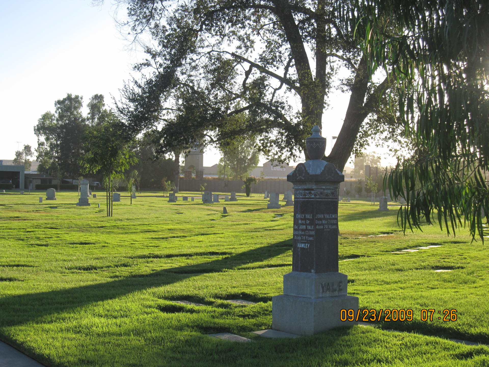 burial grounds with a tall headstone in the foreground