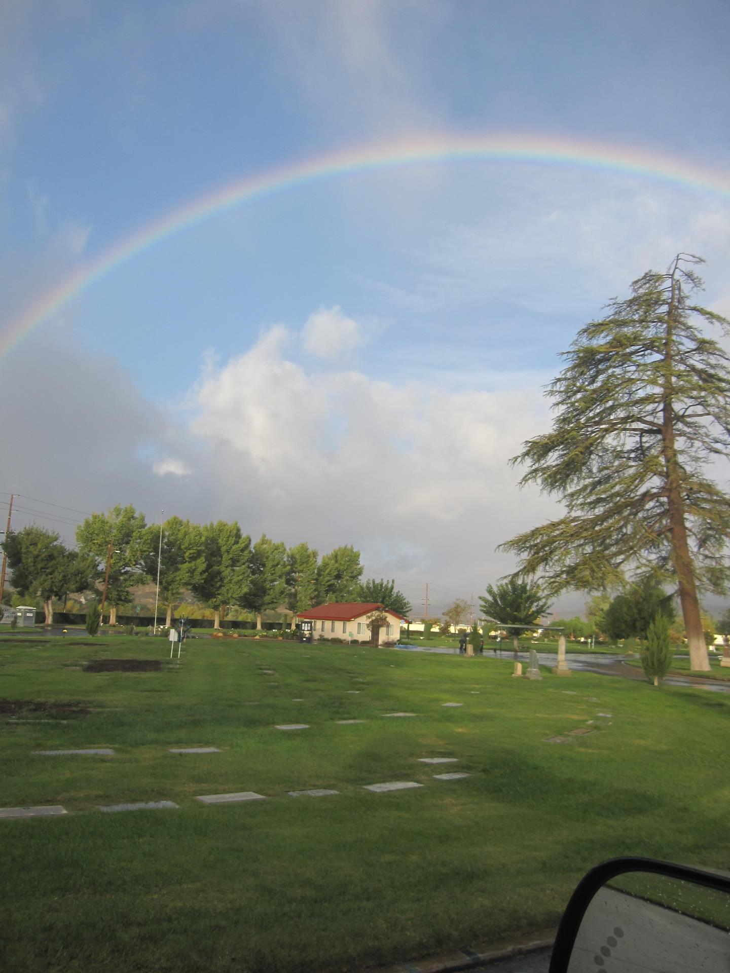 view of the cemetery with a rainbow overhead