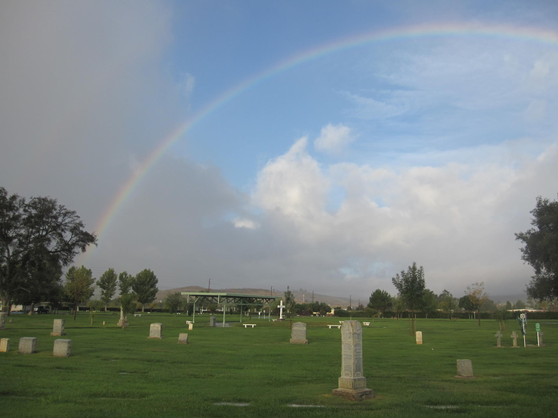 rainbow arching over the cemetery